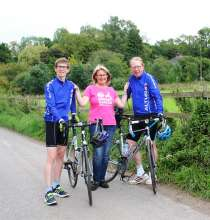 Ness Hawkings with her husband, Hugo, and son Inigo (16) before they start their cycle challenge in aid of the new Breast Cancer Unit at Salisbury Dis