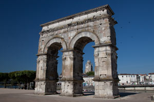 a triumphal arch, built where the main Roman road crossed the Charente river.